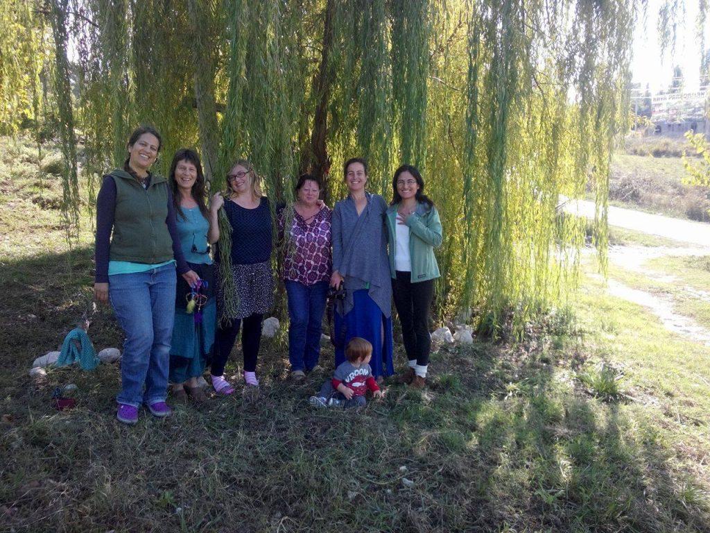 Women at a Goddess Full Moon Gathering under the wishing tree at Natural Springs Retreat, Turkey