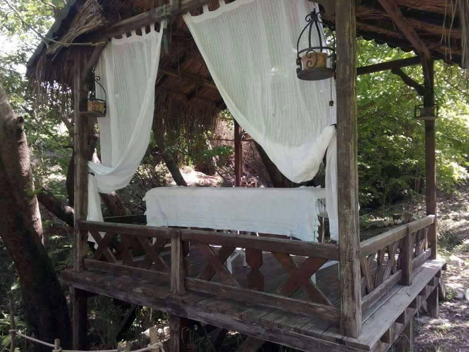 Practice your yoga, book a massage or just relax on the chill out platform by the waterfall. Courtesy of NaturalSpringsRetreat.com